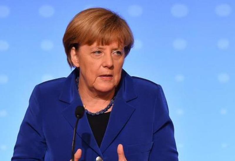 Merkeldən miqrant açıqlaması