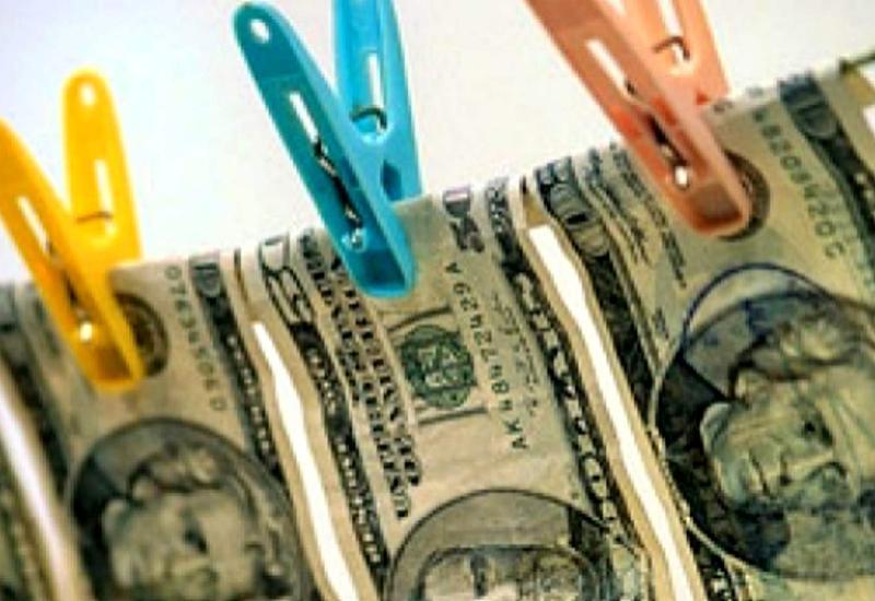 Фальшивые доллары на рынке Азербайджана