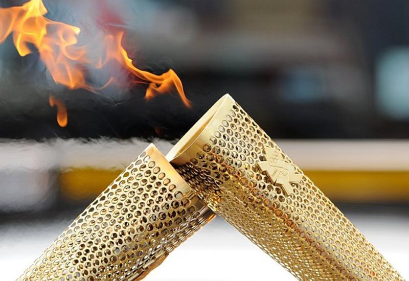 """Олимпийский огонь доставили в штаб-квартиру ООН в Женеве <span class=""""color_red"""">- ВИДЕО</span>"""