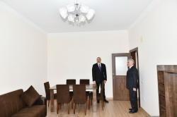 Президент Ильхам Алиев принял участие в сдаче в эксплуатацию жилого здания для офицеров и прапорщиков МЧС