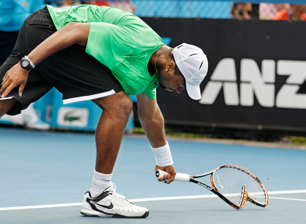 titillating tennis player can't believe the size of his racket  85356
