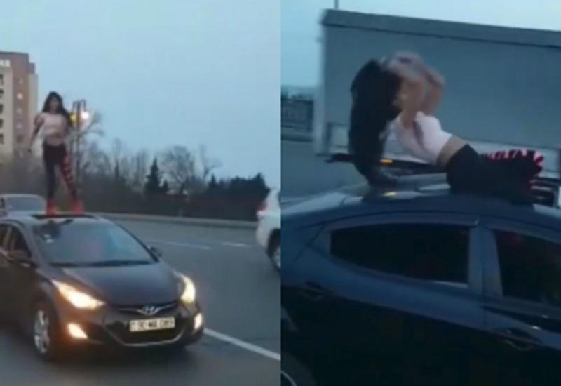 В центре Баку девушка вызвала всеобщее удивление горячим танцем на автомобиле