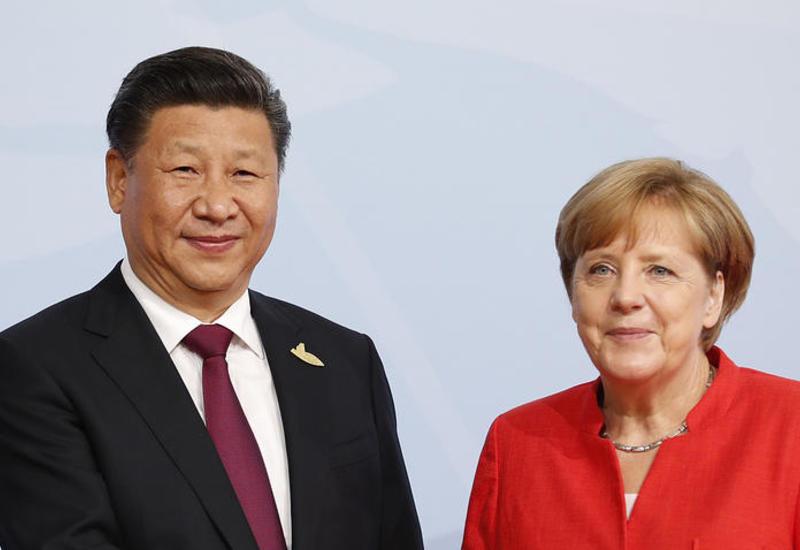 Си Цзиньпин и Меркель обсудили ситуацию по иранской ядерной сделке