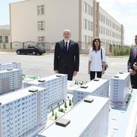 """Президент Ильхам Алиев и его супруга Мехрибан Алиева приняли участие в открытии жилого комплекса «Гобу Парк» для вынужденных переселенцев <span class=""""color_red"""">- ФОТО</span>"""