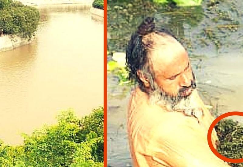 """Просто невероятно, что мужчина делает в этой грязной реке <span class=""""color_red"""">- ВИДЕО</span>"""