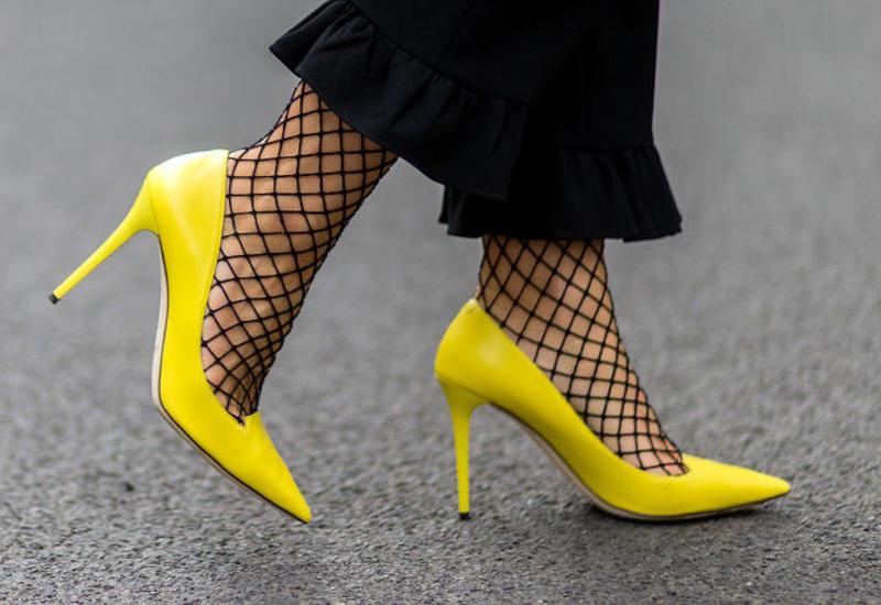 Почему женщины любят носить туфли на высоком каблуке?
