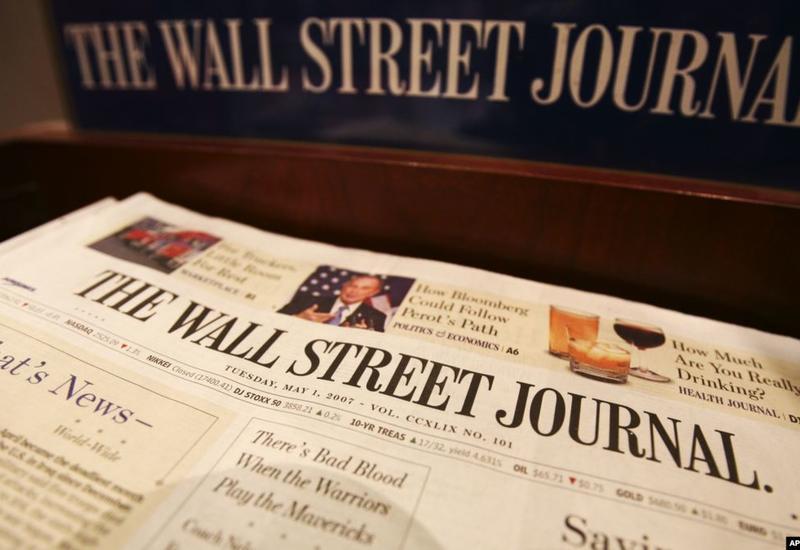 Китай аннулировал аккредитацию троих журналистов Wall Street Journal