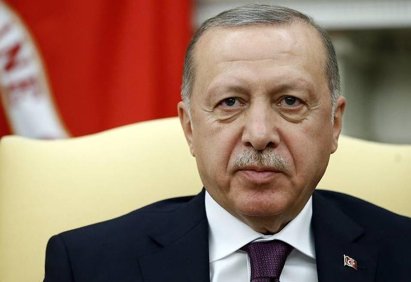 Эрдоган провел телеконференцию с Меркель и Макроном