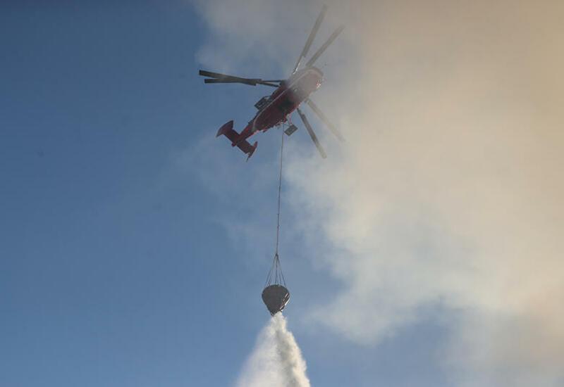 Вертолеты 80 раз сбрасывали воду на пожар в Москве