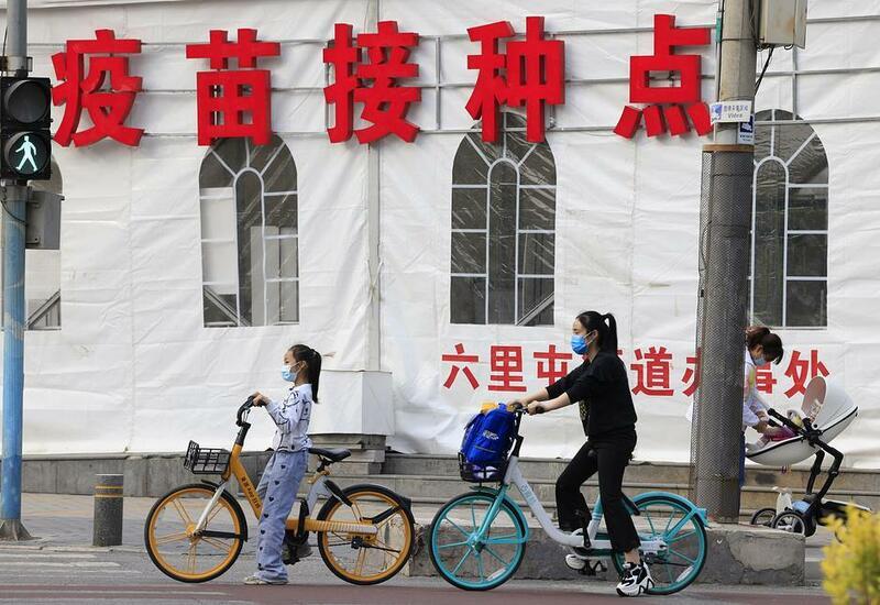 В Китае отменили штрафы за рождение трех детей