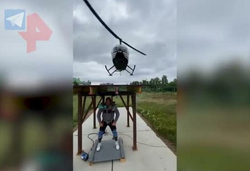 Новый рекорд: самый сильный человек России поднял вертолет