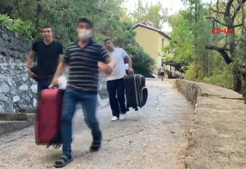 Бегут от огня с чемоданами: кадры эвакуации людей из городов Турции