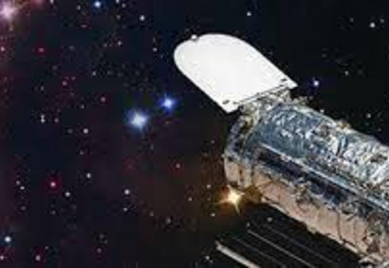 Телескоп Хаббл запечатлел изящный танец между двумя взаимодействующими галактиками