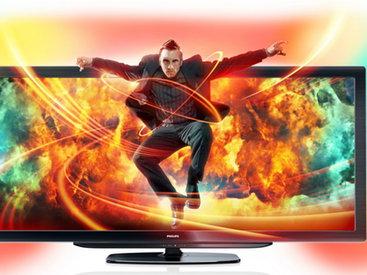 Philips проецирует фоновое изображение на стену за телевизором